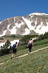 Caucasian women hiking on the Herman Gulch Trail in James Peak Wilderness Area Near Georgetown, Colorado, USA .  John leads private photo tours in Boulder and throughout Colorado. Year-round.
