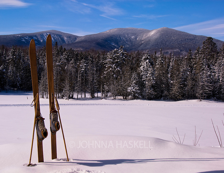Crocker mountain with old skis at the Outdoor Touring Center pond in Carrabassett Valley, Maine.