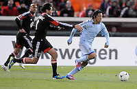 Sporting Kansas City midfielder Roger Espinoza (15) goes against D.C. United defender Dejan Jakovic (5) Sporting Kansas City defeated D.C. United  1-0 at RFK Stadium, Saturday March 10, 2012.
