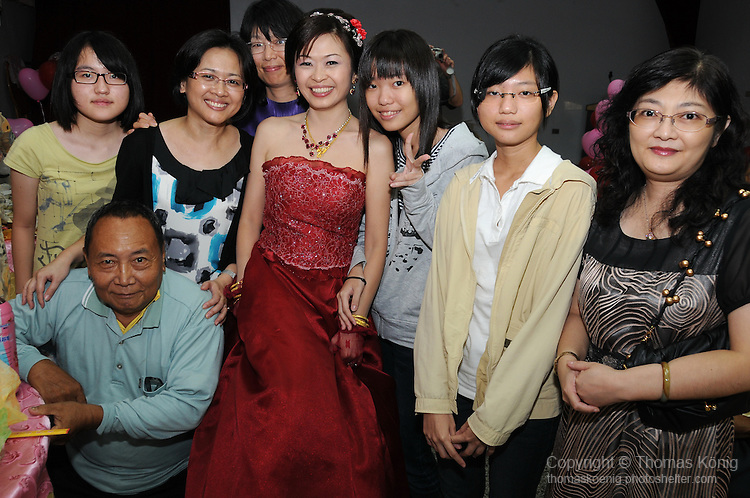 Taiwanese Wedding -- The bride posing with some of the wedding guests at the banquet.