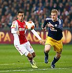 Nederland, Amsterdam, 20 februari 2014<br /> Europa League<br /> Seizoen 2013-2014<br /> Ajax-FC Salzburg<br /> Ricardo Kishna (l.) van Ajax en Martin Hinteregger strijden om de bal