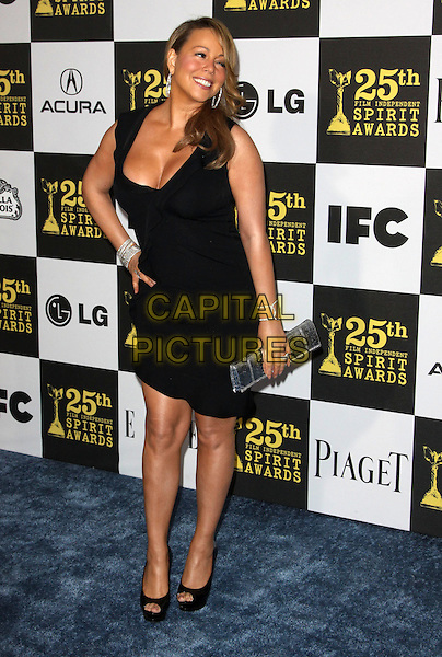 MARIAH CAREY.25th Annual Film Independent Spirit Awards held At The Nokia LA Live, Los Angeles, California, USA,.March 5th, 2010 ..arrivals Indie Spirit full length black dress cleavage sleeveless low cut peep toe platform shoes bracelets silver clutch bag hand on hip .CAP/ADM/KB.©Kevan Brooks/Admedia/Capital Pictures