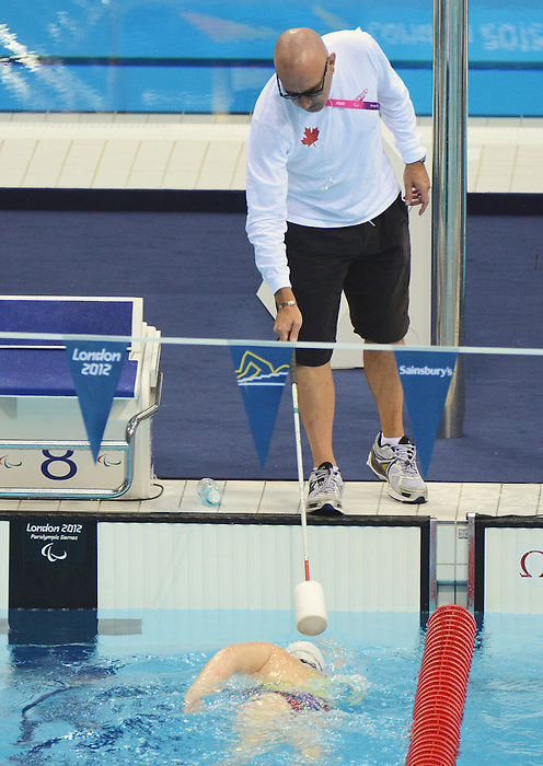 LONDON, ENGLAND – 08/24/2012: Craig McCord Head Coach of the Canadian Swim Team during a training session at the London 2012 Paralympic Games at The Aquatic Centre. (Photo by Matthew Murnaghan/Canadian Paralympic Committee)