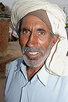Portrait of Indian man with turban in Rajasthan, India.
