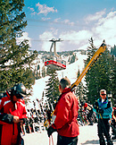 USA, Utah, a man watches the tram at the Snowbird Ski Resort base