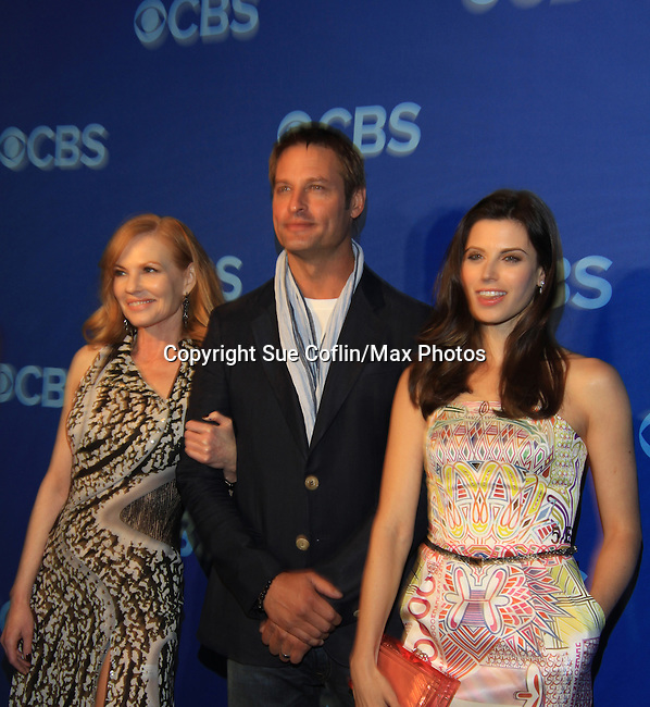 Marg Helgengerger and Josh Holoway and Meghan Ory at the CBS Upfront on May 15, 2013 at Lincoln Center, New York City, New York. (Photo by Sue Coflin/Max Photos)
