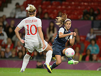Manchester, England - Monday, August 6, 2012: The USA defeated Canada 4-3 in overtime in the semi-final round of the 2012 London Olympics at Old Trafford. Alex Morgan centers the ball.