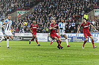 Mike van der Hoorn of Swansea City (C) fails to score from a team mate's cross during the Premier League match between Huddersfield Town and Swansea City and at the John Smith's Stadium Huddersfield, England, UK. Saturday 10 March 2018