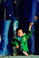 Child in a queue waiting to enter the Forbidden City in Beijing, China