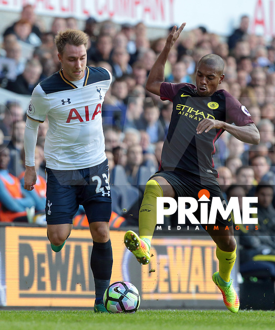 L-R Tottenham Hotspur's Christian Eriksen and Manchester City's Fernandinho<br /> during the Premier League match between Tottenham Hotspur and Manchester City at White Hart Lane, London, England on 2 October 2016. Photo by Kieran  Galvin / PRiME Media Images.