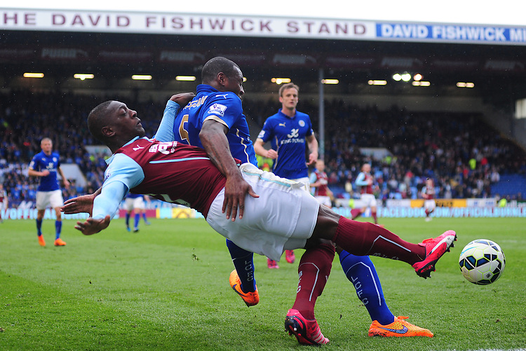 Burnley's Marvin Sordell vies for possession with Leicester City's Wes Morgan<br /> <br /> Photographer Chris Vaughan/CameraSport<br /> <br /> Football - Barclays Premiership - Burnley v Leicester City - Saturday 25th April 2015 - Turf Moor - Burnley<br /> <br /> &copy; CameraSport - 43 Linden Ave. Countesthorpe. Leicester. England. LE8 5PG - Tel: +44 (0) 116 277 4147 - admin@camerasport.com - www.camerasport.com