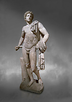 Roman statue of Apollo .Marble. Perge. 2nd century AD. Antalya Archaeology Museum; Turkey.  Against a grey background