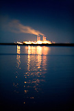 MEXICO, Baja, Magdalena Bay, Pacific Ocean, the diesel factory lighting up Magdalena Bay and the night sky
