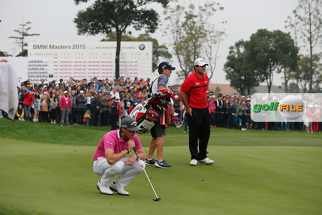 Kristoffer Broberg (SWE) on the 18th with Patrick Reed (USA) looking on during the final round of the BMW Masters, Lake Malarian Golf Club, Boshan, Shanghai, China.  15/11/2015.<br /> Picture: Golffile | Fran Caffrey<br /> <br /> <br /> All photo usage must carry mandatory copyright credit (&copy; Golffile | Fran Caffrey)