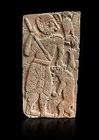 Pictures & images of the North Gate Hittite sculpture stele depicting Hittite God hunting a lion. 8th century BC. Karatepe Aslantas Open-Air Museum (Karatepe-Aslantaş Açık Hava Müzesi), Osmaniye Province, Turkey. Against black background