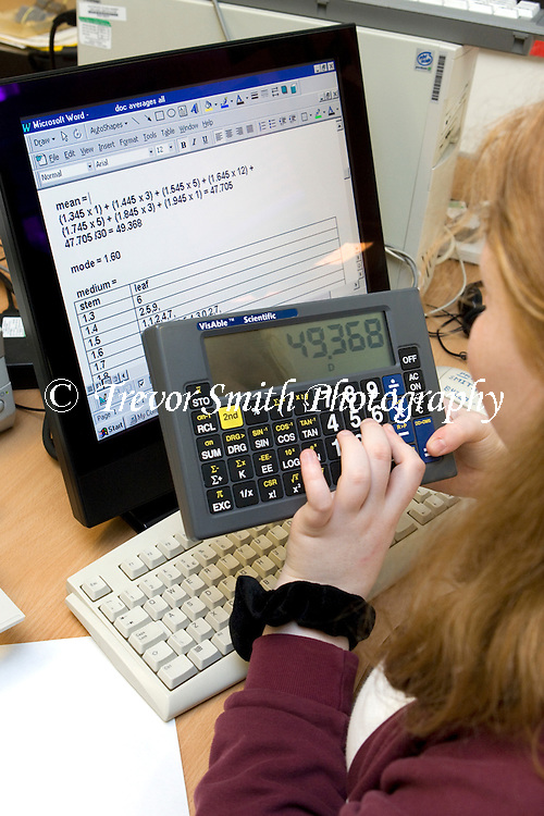 Visually impaired Child using large buttoned scientific calculator