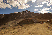 Image of the recover operation at a landslide site near Khardungla Pass in the Himalayas at 18000 feet above sea level. Rocks were blasted with dynamite and then bulldozed into the valley below to clear the roads,