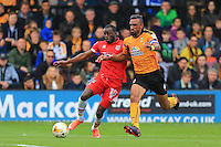Tom Bolarinwa tackled in the box by Cambridge's Leon Legge during the Sky Bet League 2 match between Cambridge United and Grimsby Town at the R Costings Abbey Stadium, Cambridge, England on 15 October 2016. Photo by PRiME Media Images.