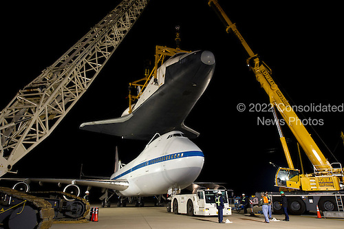 The NASA 747 Shuttle Carrier Aircraft (SCA) moves into place for mating underneath the space shuttle Enterprise at Washington Dulles International Airport, Friday, April 20, 2012, in Sterling, Va.   Enterprise, the first orbiter built for the Space Shuttle Program, was used primarily for ground and flight tests within the atmosphere. The initial testing period named Approach and Landing Test (ALT) included a flight on February 18, 1977 atop a Shuttle Carrier Aircraft (SCA) to measure structural loads and ground handling and braking characteristics of the mated system. Enterprise will go on permanent display at the Intrepid Sea Air and Space Museum in New York in June..Mandatory Credit: Bill Ingalls / NASA via CNP
