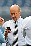 28 September 2010: Washington Nationals' Team President Stan Kasten checks for messages prior to a game against the Philadelphia Phillies at Nationals Park in Washington, DC. The Nationals defeated the Phillies 2-1 on an Adam Dunn walk-off solo homer in the 9th inning to even up their 3-game series one game apiece. Mandatory Credit: Ed Wolfstein Photo