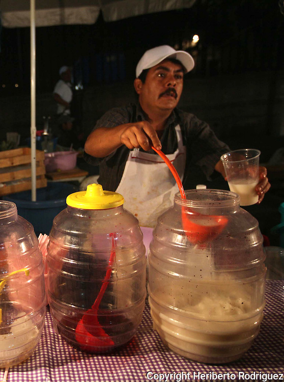 A Mexican vendor sells fresh fruit waters in a street stand in morelia city, in western state of Michoacan, April 2, 2010. Photo by Heriberto Rodriguez