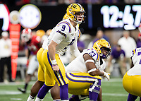 ATLANTA, GA - DECEMBER 7: Joe Burrow #9 of the LSU Tigers calls signals before a play during a game between Georgia Bulldogs and LSU Tigers at Mercedes Benz Stadium on December 7, 2019 in Atlanta, Georgia.