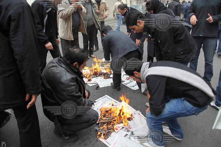 People huddle around small fires started in order to burn off the teargas fired by the security forces during protests in central Tehran. Following the massive post-election demonstrations held by opposition groups during the summer of 2009, another series of protests began after the death of Iran's most senior dissident cleric, Grand Ayatollah Hossein Ali Montazeri, a man seen by many as the spiritual father of Iran's reformists.