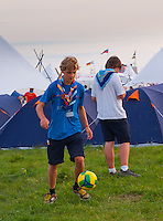 A scout is playing soccer on the field.