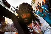 A Peruvian actor Mario Valencia, known as Cristo Cholo, performs as Jesus Christ in the Good Friday procession during the Holy week in Lima, Peru, 30 March 2013. The annual Passion Of Christ procession, held as part of Easter celebrations, starts in Lima downtown and, followed by thousands of catholic believers, it climbs to the top of the dry and rocky hill of San Cristobal, where Mario Valencia, who has been playing the role of Jesus Christ for more than 30 years, is symbolically crucified.