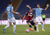 Calcio, Serie A: Lazio vs Bologna. Roma, stadio Olimpico, 22 agosto 2015.<br /> Bologna Mattia Destro, center, in action between Lazio&rsquo;s Sergej Milinkovic-Savic, left, and Stefan Radu, during the Italian Serie A football match between Lazio and Bologna at Rome's Olympic stadium, 22 August 2015.<br /> UPDATE IMAGES PRESS/Isabella Bonotto