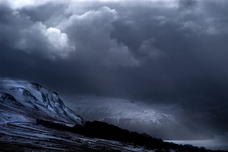 Dark stormy skies over mountains and lakes