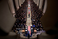 The flag-draped casket of former President George H.W. Bush is arrives carried by a military honor guard during a State Funeral at the National Cathedral, Wednesday, Dec. 5, 2018,  in Washington. <br /> CAP/MPI/RS<br /> &copy;RS/MPI/Capital Pictures