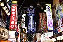 Osaka, JP - January 21, 2015 : Neon signs of restaurants and Tsutenkaku Tower in the Shinsekai shopping district of Osaka, Japan. (Photo by Rodrigo Reyes Marin/AFLO)