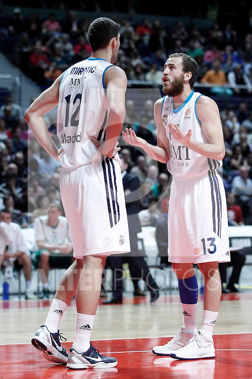 Real Madrid's Nikola Mirotic (l) and Sergio Rodriguez during Euroleague 2012/2013 match.January 11,2013. (ALTERPHOTOS/Acero)
