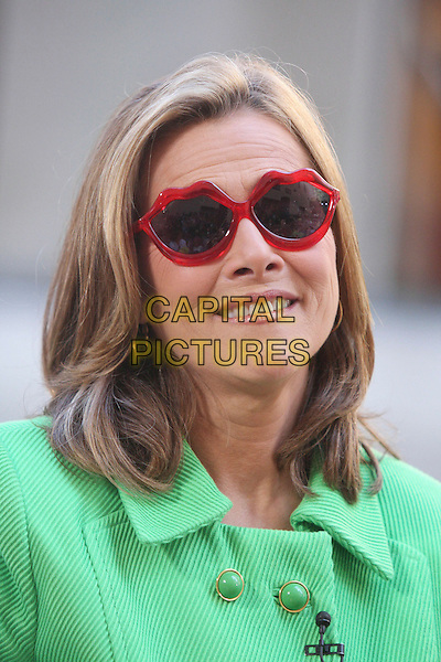 MEREDITH VIEIRA .Seen on the 'Today Show' in Rockefeller Plaza, New York, NY, USA, .July 24th 2009..portrait headshot red sunglasses mouth lips shaped green .CAP/LNC/RAF.©LNC/Capital Pictures