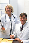portrait of smiling male and female medical doctors