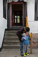 A visually impaired Tibetan student washes the face of a younger one in the morning at the School for the Blind in Tibet, in the capital city of Lhasa, September 2016.