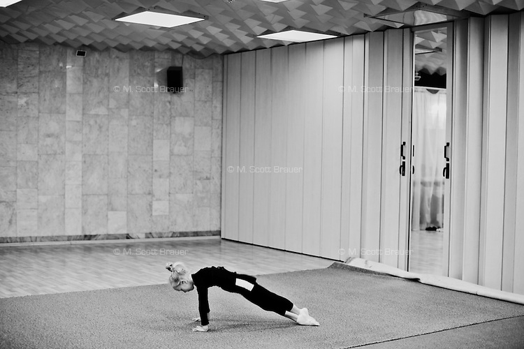 Girls age 4 and 5 stretch during rhythmic gymnastics training at the Dinamo Sports Palace in Moscow, Russia. The girls have been training for about 3 months.