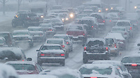 Commuters struggle through an afternoon snowstorm in Columbus, Ohio, Wednesday, December 22, 2004.