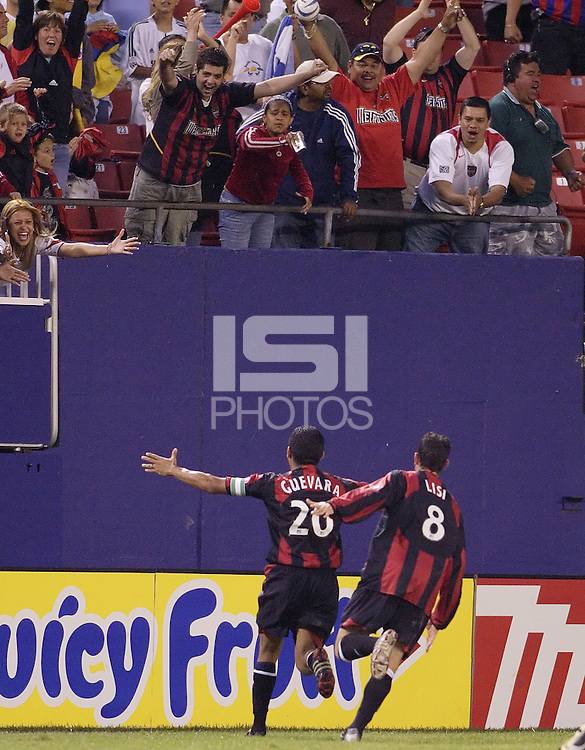 The MetroStars' Amado Guevara and Mark Lisi celebrate Guevara's game winning stoppage time goal. The MetroStars defeated the Chicago Fire  2 - 1 at Giant's Stadium, East Rutherford, NJ, on May 31, 2005.