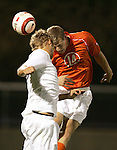 1 November 2006: Clemson's Jeff Routh (14) wins a header against Virginia's Adam Cristman (left). Virginia defeated Clemson 2-0 at the Maryland Soccerplex in Germantown, Maryland in an Atlantic Coast Conference college soccer tournament quarterfinal game.