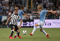 Calcio, finale Tim Cup: Juventus vs Lazio. Roma, stadio Olimpico, 20 maggio 2015.<br /> Juventus' Arturo Vidal, left, is challenged by Lazio's Marco Parolo and Dusan Basta, right, during the Italian Cup final football match between Juventus and Lazio at Rome's Olympic stadium, 20 May 2015.<br /> UPDATE IMAGES PRESS/Isabella Bonotto