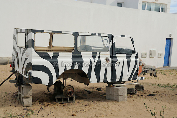 Spain, Canary Islands, Archipielago Chinijo, Isla Graciosa, Caleta del Sebo. Broken up Land Rover Santana donor vehicle. --- No releases available. Automotive trademarks are the property of the trademark holder, authorization may be needed for some uses.