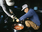 Workers fertilize eggs at  the Towada Salmon Hatchery in Towada, Japan where volunteers catch salmon to fertilize eggs. 30 million young salmon each year are placed in the Oirase River to help in Japan's conservation efforts to replace the salmon taken for food. Most of their work is done during the salmon-spawning season during the fall as the fish begin their annual trek and battle their way through rushing currents and over boulders several miles upstream from the mouth of the river past the hatchery to spawn. (Jim Bryant Photo).....