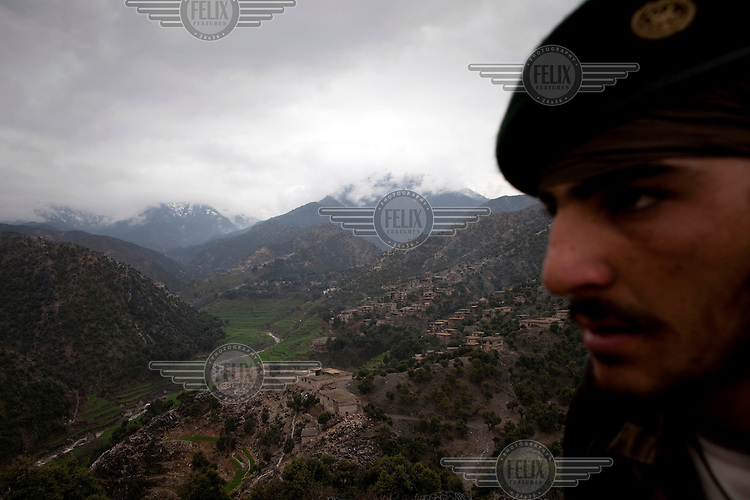 An ANA (Afghan National Army) soldier keeps guard at an outpost monitoring the restive Korengal Valley, epicentre of the war and scene of fierce fighting with the Taliban.