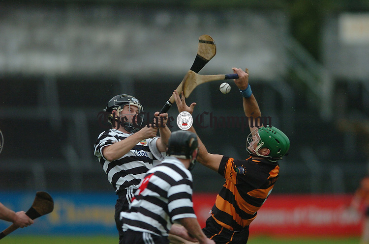 Clarecastle's Danny Scanlan in action against Tubber's Barry O Connor during their match in Cusack Park. Photograph by John Kelly.