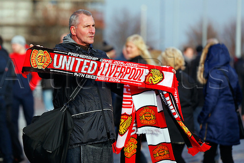 14.12.2014.  Manchester, England. Premier League. Manchester United versus Liverpool. Scarf sellers outside the ground