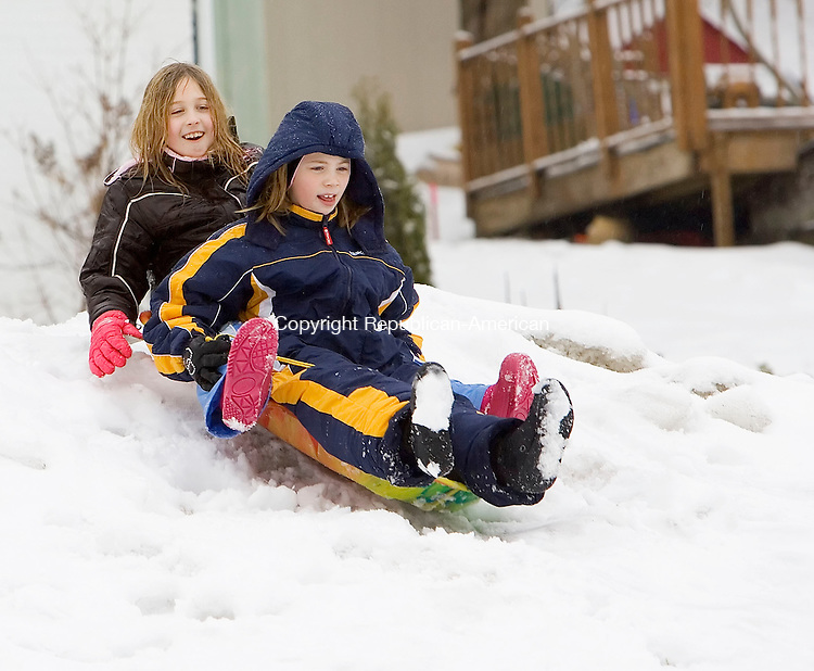 WATERBURY, CT- 01 JAN 2008- 010108JT03-<br /> Mariah Dumaine, 9,  rides behind Alyssa Voigt, also 9, on a sled at Sanford Avenue Field in Thomaston on Tuesday, New Year's Day.<br /> Josalee Thrift / Republican-American