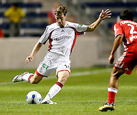 New England Revolution midfielder Steve Ralston (14) prepares to kick the ball as Chicago Fire midfielder Ivan Guerrero (23) defends.  The Chicago Fire defeated the New England Revolution 2-1 in the quarterfinals of the U.S. Open Cup at Toyota Park in Bridgeview, IL on August 23, 2006...