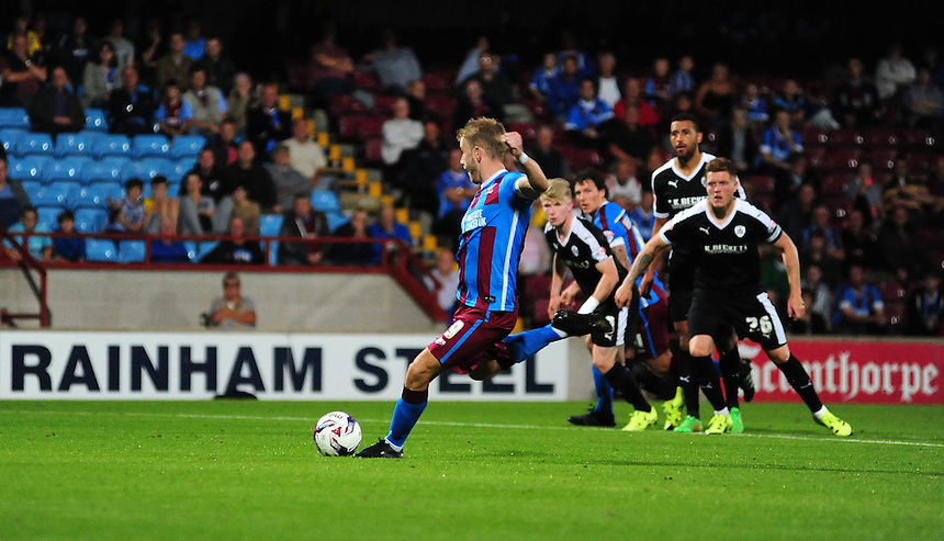 Scunthorpe United's Paddy Madden scores his sides equalising goal from the penalty spot to make the score 1-1<br /> <br /> Photographer Chris Vaughan/CameraSport<br /> <br /> Football - Capital One Cup First Round - Scunthorpe United v Barnsley - Tuesday 11th August 2015 - Glanford Park - Scunthorpe<br />  <br /> &copy; CameraSport - 43 Linden Ave. Countesthorpe. Leicester. England. LE8 5PG - Tel: +44 (0) 116 277 4147 - admin@camerasport.com - www.camerasport.com